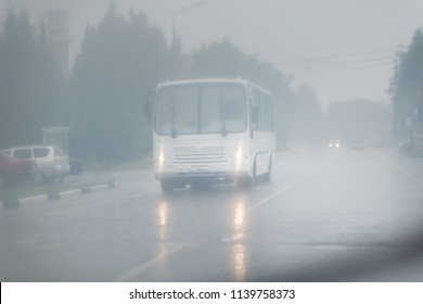 Traffic on highway on a foggy rainy day.