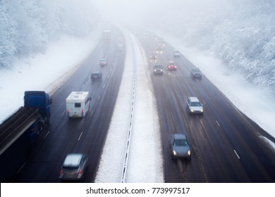 Traffic On Motorway During Snow Storm
