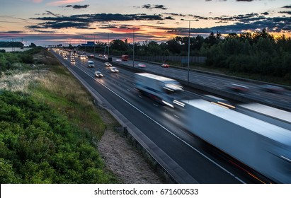 Traffic on the motorway at the dusk time