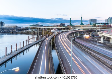 traffic on road with cityscape and skyline of portland