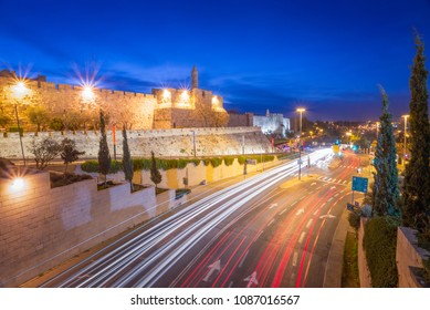 Traffic passing by the outer walls of the old city, Jerusalem