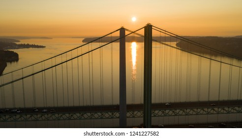 Traffic pays to cross the bridge in one direction as the afternoon fades over Puget Sound in Washington