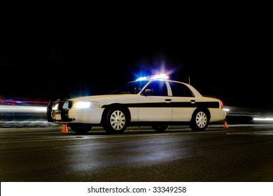 Traffic police car with lights on & motion blur behind it