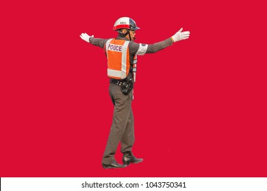 Traffic policeman isolated on red background.