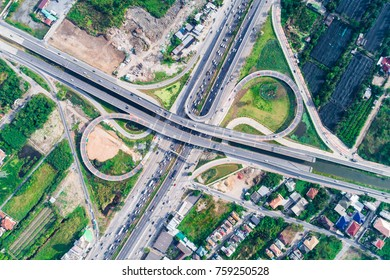 Traffic road junction view from above with green tree circle road