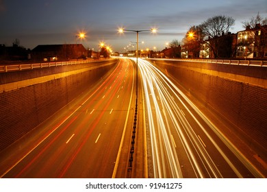 Traffic Road at Night. Long exposure of busy road at dawn.