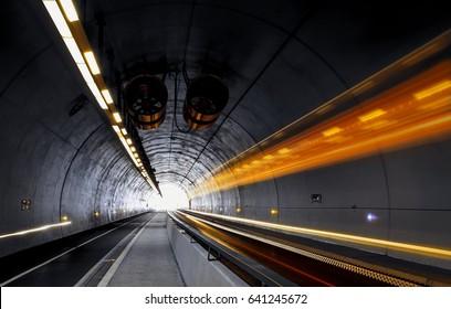 Traffic rushing through a modern tunnel. Traffic concept.