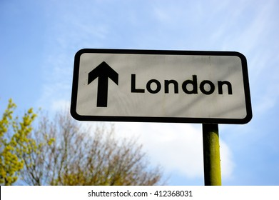 Traffic sign, the arrow pointing to London, England, UK