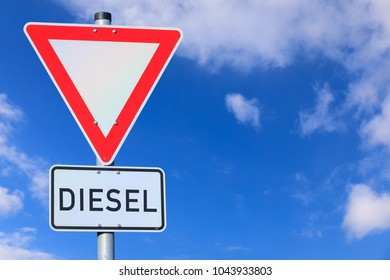 traffic sign, attention diesel, blue sky