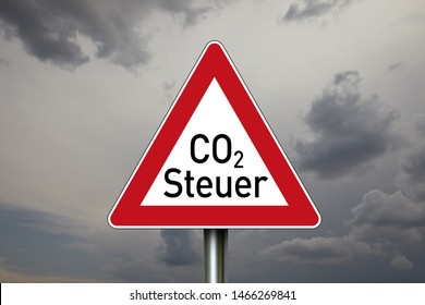 Traffic sign with dark sky in the background and the german word for CO2-Tax - CO2-Steuer