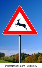 a traffic sign for deer pass with background