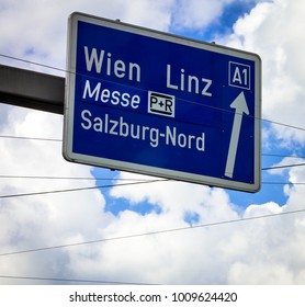 Traffic sign of direction to 1 highways in the Linz,Messe, Vienna on cloudy summer sky background. Salzburg. Austria