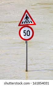Traffic sign in flood in the Danube