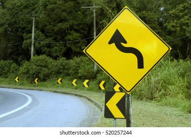 """Traffic sign """"left curves"""", on road with many curves - Sao Paulo, SP, Brazil - April 30, 2016"""
