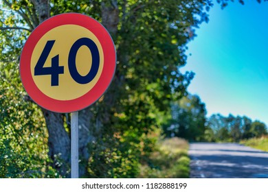 Traffic sign in limiting the speed to 40 kph at the road. Sweden