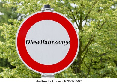Traffic sign with the meaning of a ban on passage and the inscription Diesel vehicles, transit prohibited for diesel vehicles