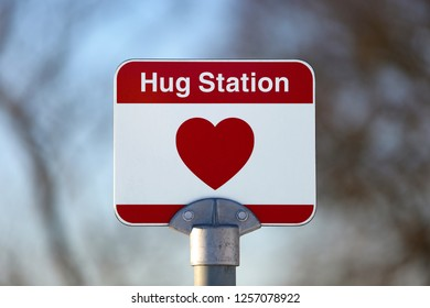 Traffic sign and a meeting place for hugs.