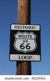 Traffic sign on the American highway, on a wooden column. Historic route 66