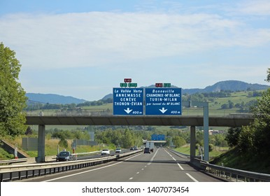 traffic sign on the highway in France with names of many french and italian city in french language and the way by White Mount to go to Italy