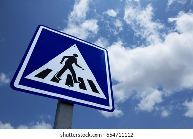 Traffic sign on road, Crosswalk road warning sign against the sky