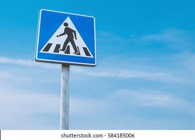Traffic sign / Pedestrian crossing /Zebra on blue sky background
