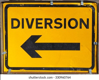Traffic sign for road diversion in black over yellow
