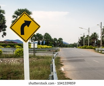 """Traffic sign """"Turn Right"""" along the road"""