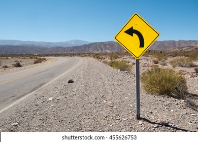 Traffic sign warning of a bend in the Argentinian Andes