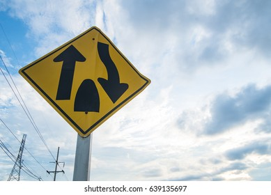 Traffic sign, The way forward is a shared way with no islands or anything else dividing the traffic. Drive slower and to the left of the way. And be more careful. sky background.