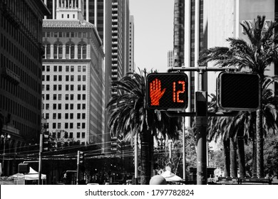 Traffic Signal Do Not Walk Illuminated Sign in a Busy City Street. Red Hand Color Isolated Stoplight at a Pedestrian Crosswalk Intersection