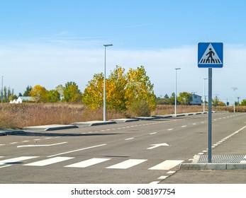 Traffic signal on a crosswalk on a village