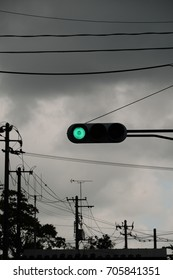 Traffic signals, Stormy sky. The green light means go.