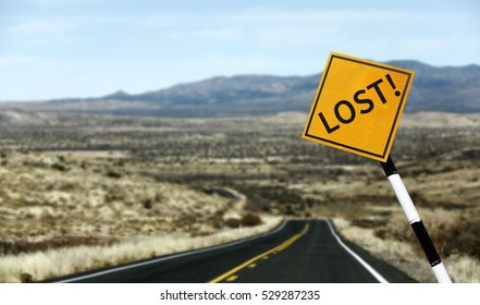 A traffic signpost with imprint of the word Lost along a lonely deserted highway to nowhere for the concept: Lost in the wilderness.