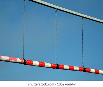 traffic signs in front of the bridge or the entrance to the garage using plastic rollers hanging over the road on the cuts. warns of the maximum height of the vehicle before damage injury to passenger