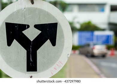 Traffic Signs in front of crossroad, Direction turn left or turn right
