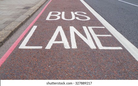 Traffic signs indicating lane reserved to buses and public transport means on a London street