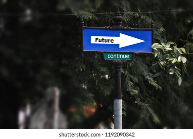 Traffic signs on the street. Have the words write the future and continue to the label.Behind the tree is a blurred image. concept:The path to go forward