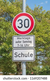 Traffic signs for speed limit on 30 km/h, on workdays in the area of a school in the time of from 7 to 16 o'clock