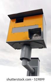 A traffic speed enforcement camera facing left.
