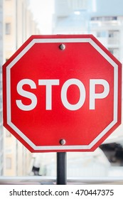 traffic stop sign with a red background.