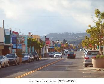 Traffic in sunny american shopping street San Mateo Ave in San Bruno, California, USA
