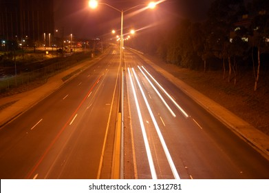 Traffic trail of car headlights at night
