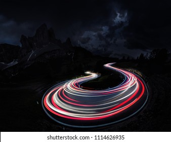 Traffic trails on mountain pass at night