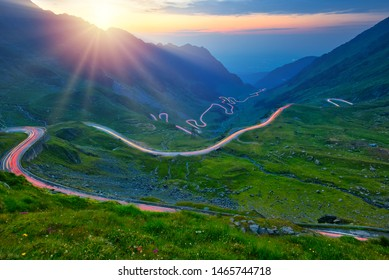 Traffic trails on Transfagarasan pass at sunset. Crossing Carpathian mountains in Romania, Transfagarasan is one of the most spectacular mountain roads in the world