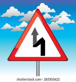 Traffic triangle shaped Left Double bend sign with post on blue sky background