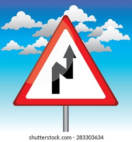 Traffic triangle shaped Right Double bend sign with post on blue sky background