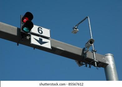 traffic-light and cctv on blue sky background