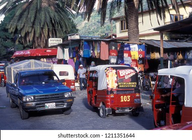 trafic at a Market in the old city in the town of Antigua in Guatemala in central America.      Guatemala, Antigua, September, 2014