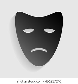 Tragedy theatrical masks. Black paper with shadow on gray background.