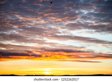 tragic sky, yellow-pink clouds, sunrise, bright colors